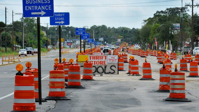 Construction crews work on the US 1 for the widening project sbetween Michigan Av and Dixon Boulevard leaving several shopkeeper along the strech in Cocoa are worried about their busineses  .