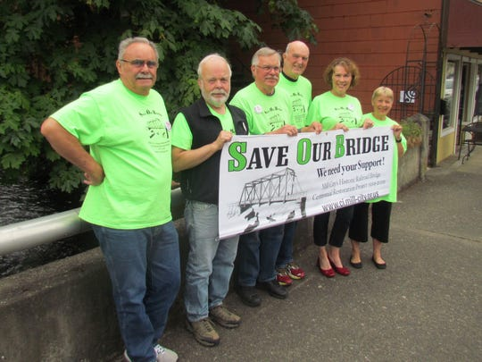 Members of Save Our Bridge (SOB) from Mill City, left to right, Dave Forward, Dennis Chamberlin, Roel Lundquist, John Gottfried, Lynda Harrington and Jan Gottfried.