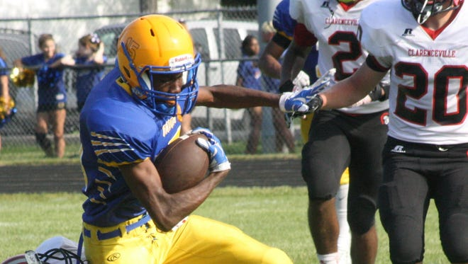 A Redford Union receiver fights for extra yardage during a game earlier this season.