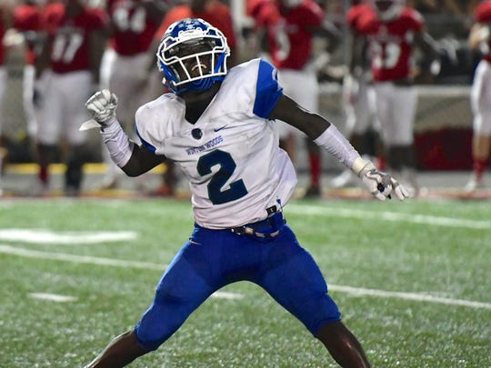 Raequan Prince celebrates a Winton Woods Warriors victory