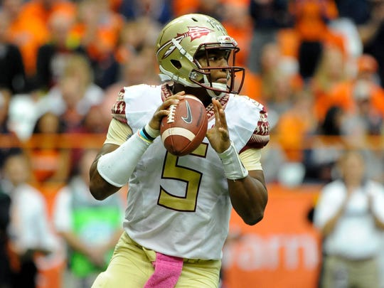 Florida State Seminoles quarterback Jameis Winston (5) drops back to pass against the Syracuse Orange during the second quarter at the Carrier Dome.