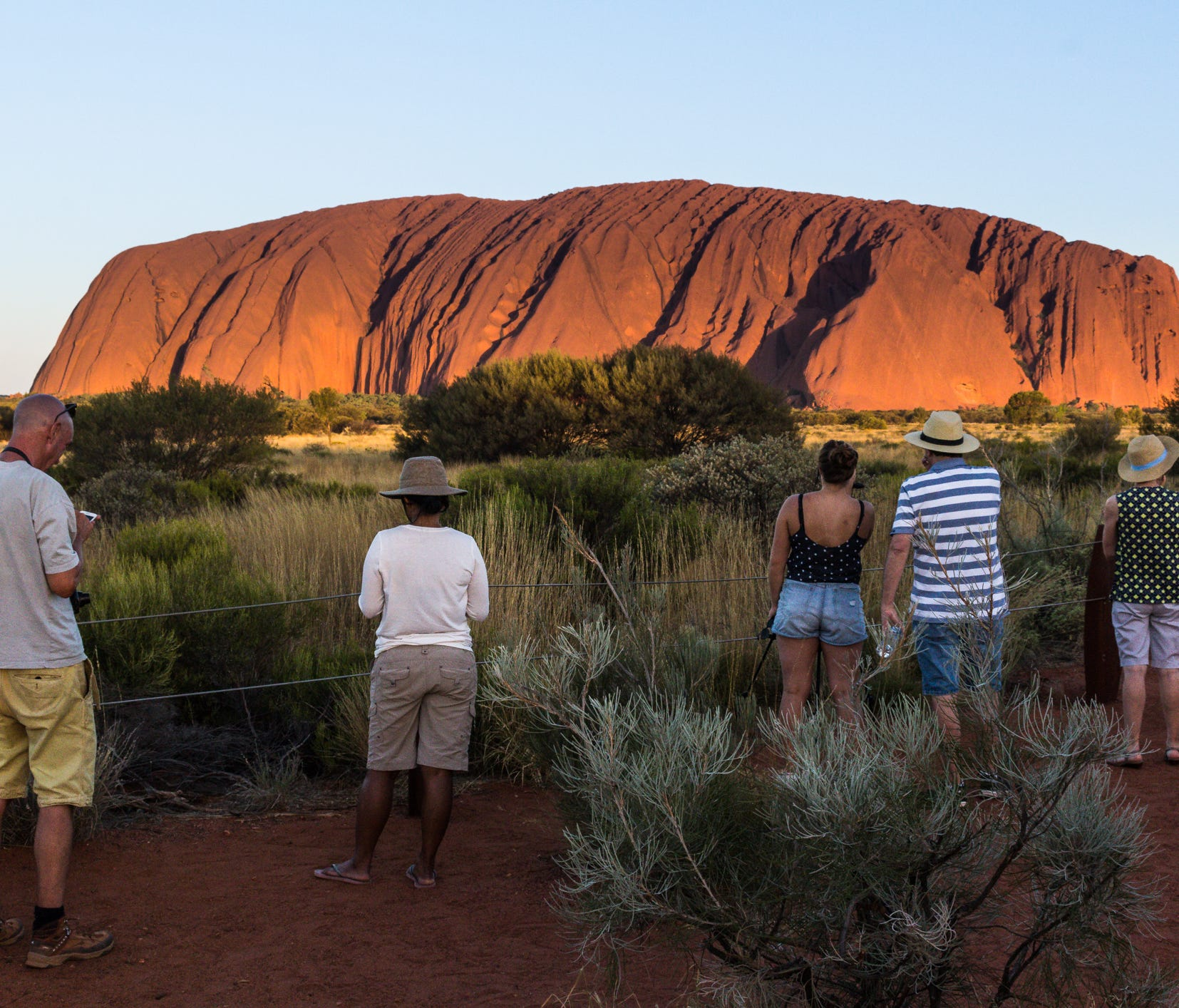 Visitors stand spellbound and transfixed by the sheer beauty of the giant rock phenomenon.