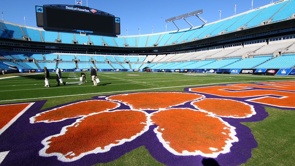 A Clemson Tiger paw is the 'O' in the word Clemson,