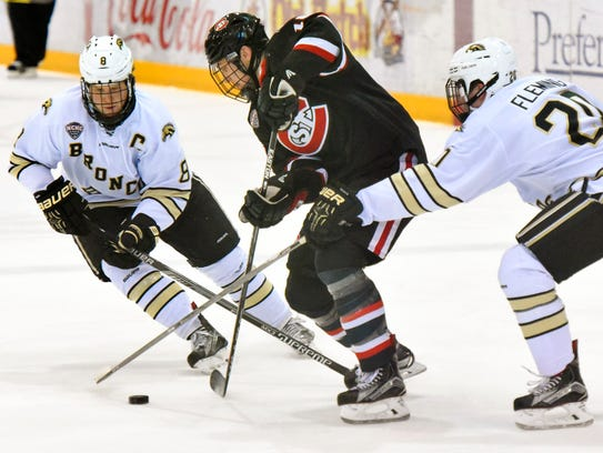 St. Cloud State's Judd Peterson (center) is blocked