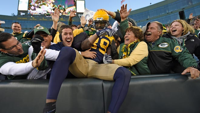 Green Bay Packers wide receiver James Jones (89) does a Lambeau Leap after catching a touchdown pass against the San Diego Chargers at Lambeau Field on Oct. 18.