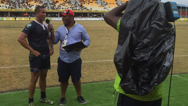 Guam rugby captain Robert Leon Guerrero is interviewed after Guam lost 21-13 to the Solomon Islands July 9 at the Pacific Games in Port Moresby, Papua New Guinea.