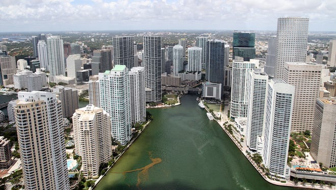 The mouth of the Miami River runs out to Biscayne Bay as it exits Downtown Miami. Floridians face the most risk from sea-level rise, where up to 6 million residents could be affected.