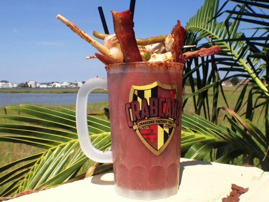 The Triple Threat Bloody Mary ($25) at the Crabcake Factory Bayside in Selbyville. The bloody mary, made with Bloody Mary vodka, comes in a 34-ounce mug and is topped with applewood bacon, shrimp, spicy green beans, jumbo lump crab and lemon and lime slices.