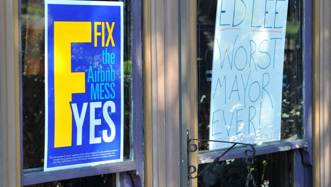 Signs showing support for Proposition F and opposition to San Francisco's current Mayor Ed Lee are seen in the window of a home in San Francisco on Nov. 3, 2015.