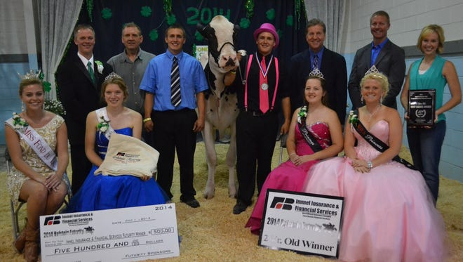 The two-year-old judging included, from front left: Malainey Myrin, 2014 Miss Fond du Lac; Katie Bock, 2014 FDL County Fairest of the Fair; Kristin Broege, 2014 WI Holstein Princess Attendant; and Kayla Krueger, 2014 WI Holstein Princess. Back left: Ryan Krohlow, judge; Steve and Derrek Kamphuis, owner; Bella-Ridge Gin Blossom-ET; Darren Kamphuis, owner; Mike Immel and Eric O'Brien, major sponsor; Kristin Olson, trophy sponsor.