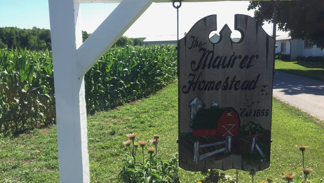 A hanging sign welcomes visitors to the Maurer Farm.