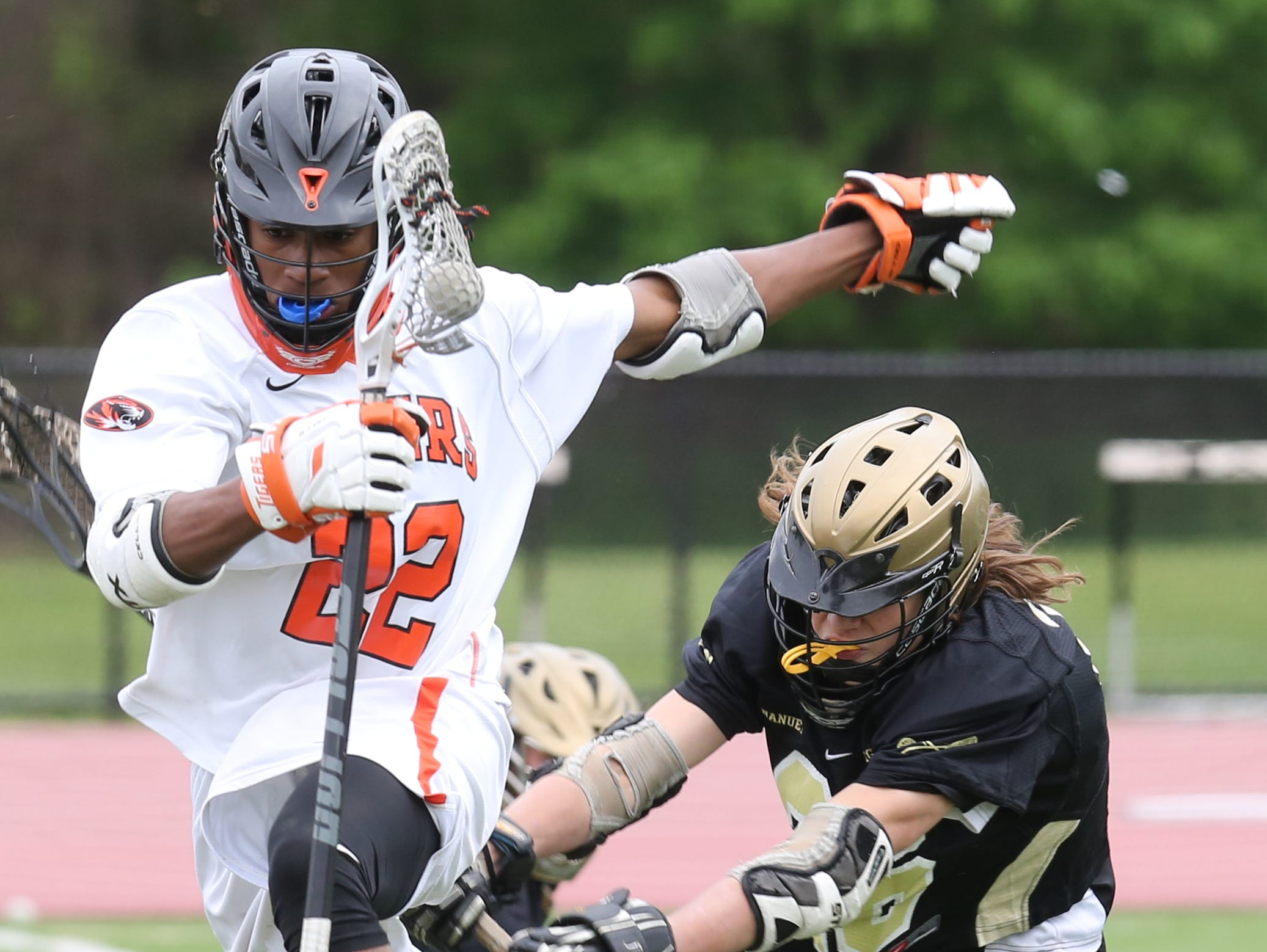 Nanuet's Randy Slavik (26) tries to steal the ball from Miles Tillman(22) of White Plains during boys lacrosse game at White Plains High School May 10, 2016. White Plains defeats Nanuet 14-4.