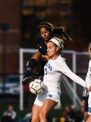 Elco's Tanisha Grewal rips a shot out of the air off