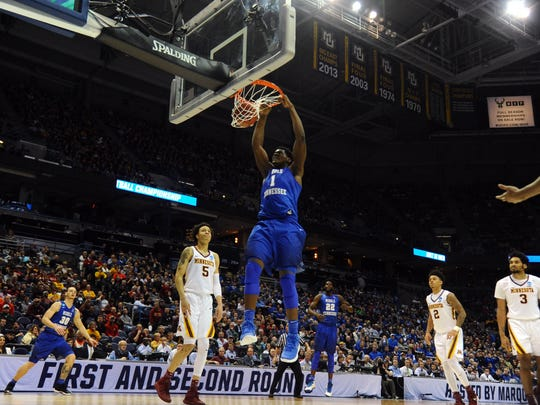 MTSU forward Brandon Walters (1) dunks the ball during the first half of the NCAA tournament first-round game in Milwaukee on March 16, 2017