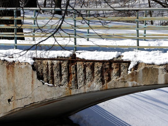 Concrete is crumbling off the pedestrian bridge over the Kinnickinnic River at Pulaski Park.