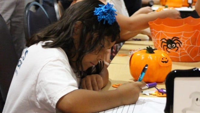 Jackie Torres fills out paperwork during a volunteer activity at Phoenix Children's Hospital.