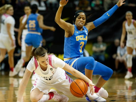 Oregon guard Sabrina Ionescu tries to steal the ball from UCLA guard Jordin Canada during overtime of their Pac-12 NCAA college basketball game in Eugene, Ore., Monday, Feb. 19, 2018. Oregon won, 101-94 in overtime. (Andy Nelson/The Register-Guard via AP)