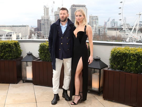 "Jennifer Lawrence (with Joel Edgerton) called controversy that sprang up because she didn't wear a coat over this Versace dress in London ""utterly ridiculous."""