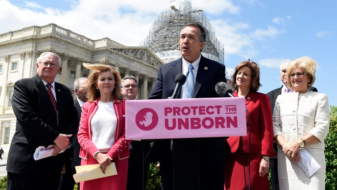 Rep. Trent Franks, R-Ariz., center, speaks during a news conference on the Pain-Capable Unborn Child Protection Act on Capitol Hill on May 13, 2015.