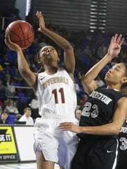 Riverdale's Aislynn Hayes (11) goes up for a shot as