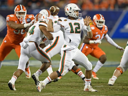 Miami's Malik Rosier (12) looks to pass against Clemson during the first half of the Atlantic Coast Conference championship NCAA college football game in Charlotte, N.C., Saturday, Dec. 2, 2017. (AP Photo/Mike McCarn)