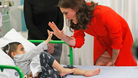 The Duchess high-fived with patient Rafael Chana, 4,