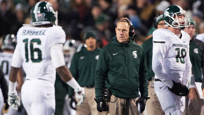 Michigan State Spartans head coach Mark Dantonio stands on the field during a timeout during the second quarter of a game against the Maryland Terrapins at Byrd Stadium.