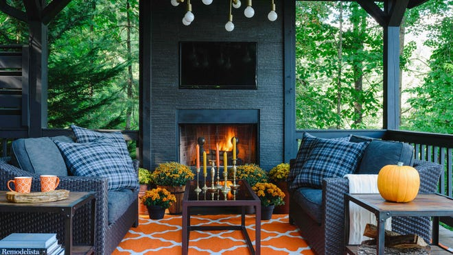 To take advantage of the gorgeous autumn weather at his mountain house, designer Brian Patrick Flynn added a modern fireplace. To enhance fall style, Flynn changes up throw pillows in October by swapping summer-tones pillow cases with those more suited for autumn.