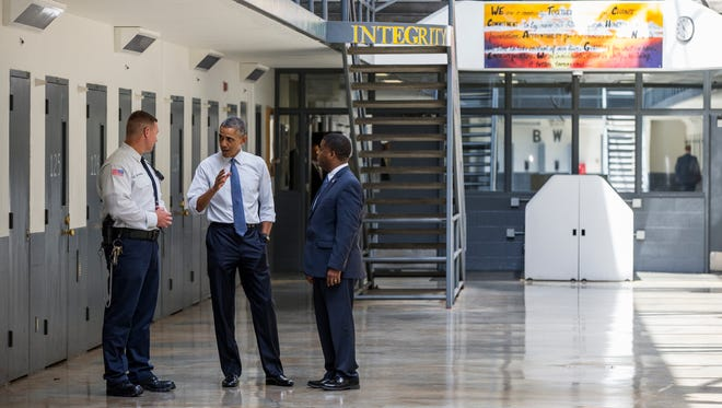 President Barack Obama speaks during a 2015 tour with the Bureau of Prisons Director Charles Samuels, right, and correctional officer Ronald Warlick, at the El Reno Federal Correctional Institution in El Reno, Okla.