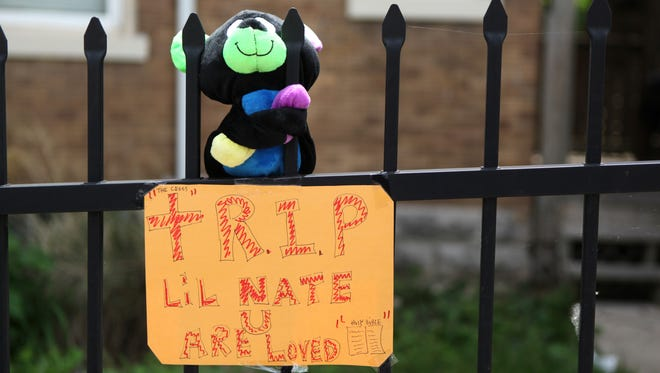 A memorial near the corner of Park Avenue and William Howard Taft Road in Walnut Hills where Nathaniel Scott Jr. was fatally shot Tuesday.