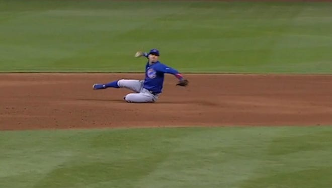 Javy Baez makes an amazing play for the Cubs.