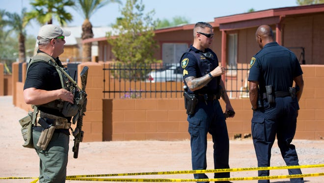 Law enforcement investigate the deaths of four people in Casa Grande on  Oct. 05, 2017.