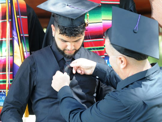 Father and son Daniel, 41, (right) and Danny Chavez, 22, of Oxnard, will be the first members of their family to graduate from college and they will do it together Saturday at California Lutheran University.