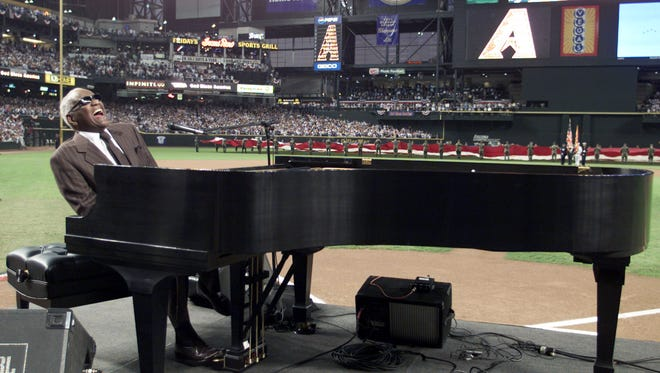 "Ray Charles performs ""America the Beautiful"" before Game 2 of the World Series between the New York Yankees and Arizona Diamondbacks Sunday, Oct. 28, 2001, at Bank One Ballpark in Phoenix."