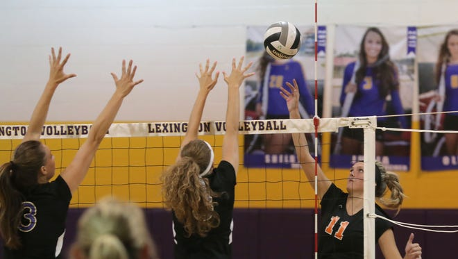 Ashland's Maddie White reaches for the ball during Thursday night's match between the Arrows and Lexington.