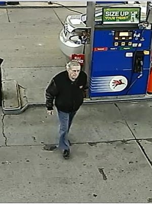 Earnest H. Moore is seen here filling up his car at a Kenosha gas station.