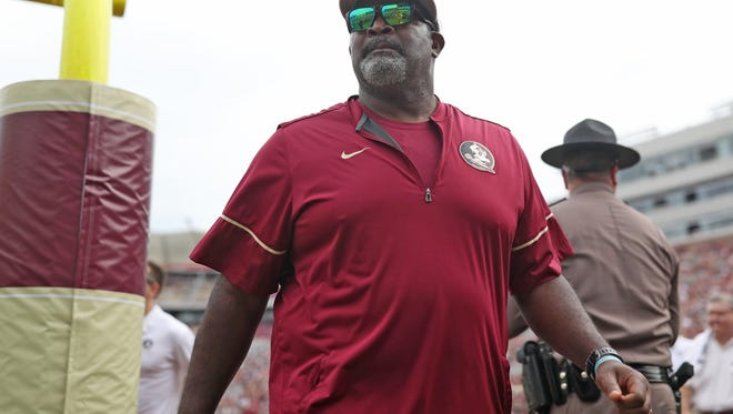 FSU Defensive Tackle's Coach Odell Haggins walks to the sidelines before their game against Miami at Doak Campbell Stadium on Saturday, Oct. 7, 2017.