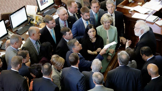 Members of the Texas House discuss a point of order, Tuesday, Aug. 15, 2017, in Austin, Texas.