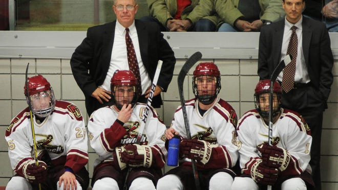 Norwich University men's hockey coach Mike McShane behind the bench at a game in the 2010-11 season in Northfield.