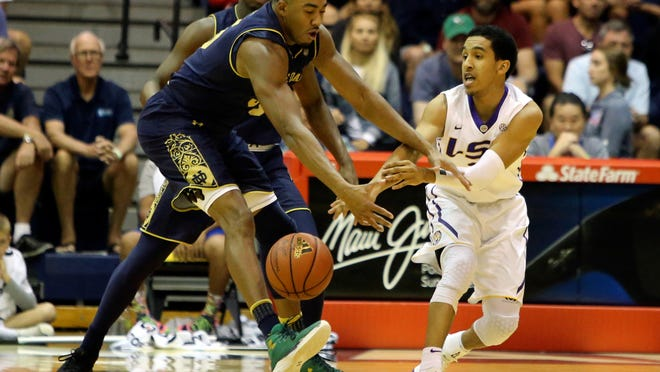 Notre Dame forward Bonzie Colson, left,  steals the ball from LSU guard Tremont Waters, right, during the first half of an NCAA college basketball game, Tuesday, Nov. 21, 2017, in Lahaina, Hawaii. (AP Photo/Marco Garcia)
