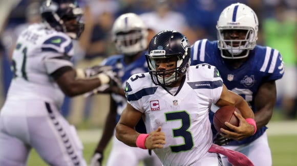 Seattle quarterback Russell Wilson runs against the Colts during an Oct. 6, 2013, game at Lucas Oil Stadium.