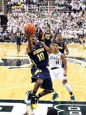 Michigan senior Derrick Walton Jr., then a freshman, scores during the Wolverines' 80-75 win at Breslin on Jan. 25, 2014. Walton is part of a Michigan roster with vastly more experience in this rivalry than MSU's roster.