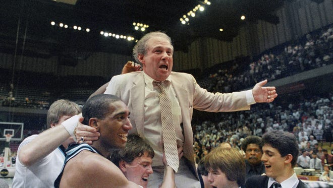 FILE - In this March 24, 1985 file photo, Villanova coach Rollie Massimino takes a victory ride on his players shoulders. Rollie Massimino, who led Villanova's storied run to the 1985 NCAA championship and won more than 800 games in his career, died Wednesday, Aug. 30, 2017 after a long battle with cancer. He was 82. (AP Photo/File)