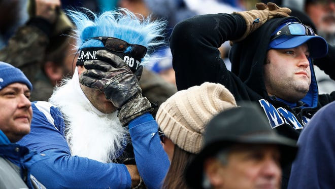 Dejected Memphis fans watch the final minutes of a 21-20 loss to Iowa State during the AutoZone Liberty Bowl in Memphis, Tenn., Saturday, December 30, 2017.