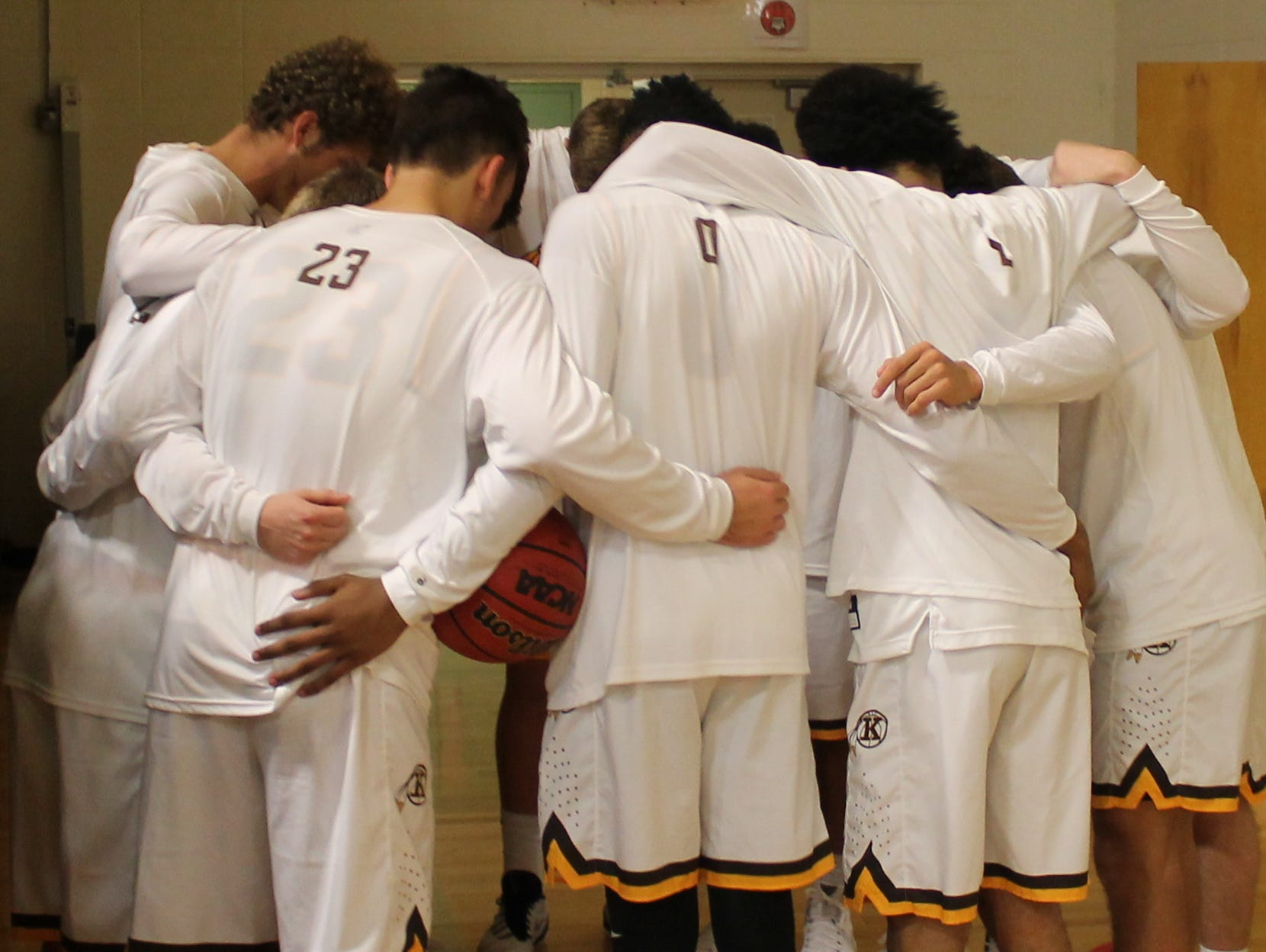 The Kickapoo High School boys basketball team takes a moment together before playing Glendale for the 2015 MBCA Hall of Fame Classic championship.