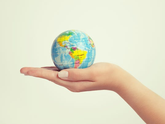 female hand holding globe. save the earth concept