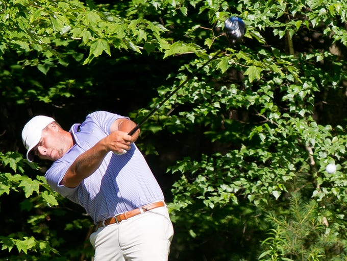 Max Major hits his drive on the 12th hole during the