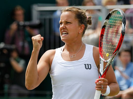 Barbora Zahlavova Strycova of the Czech Republic celebrates a point to Caroline Wozniacki of Denmark during their match at the All England Lawn Tennis Championships in Wimbledon, London, Monday, June 30, 2014. (AP Photo/Sang Tan)