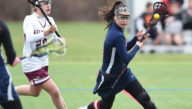 Wappingers' Jessica Lasaponara dodges an Arlington high school defender on April 8