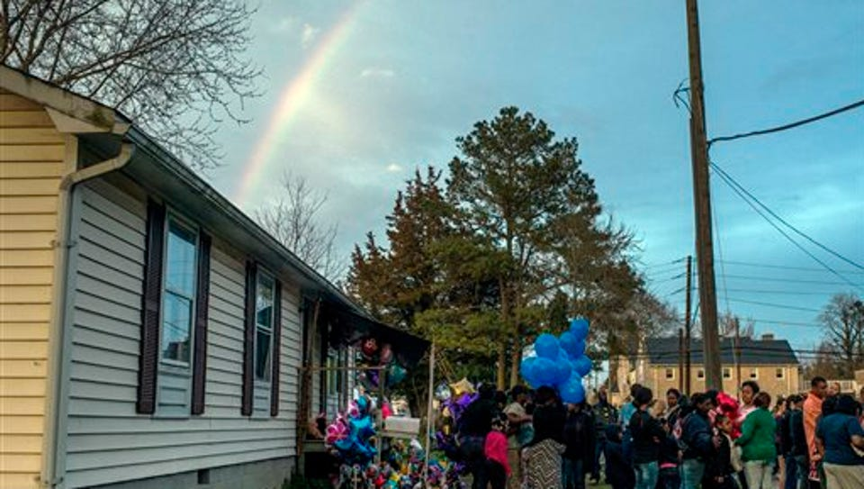 In this Friday, April 10, 2015 photo, mourners gather